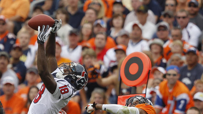 Houston Texans wide receiver Lestar Jean (18) leaps to catch a pass against Denver Broncos strong safety Chris Harris (25) in the third quarter of an NFL football game Sunday, Sept. 23, 2012, in Denver. (AP Photo/David Zalubowski)