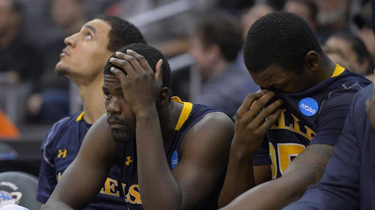 La Salle players watch from the bench as their team goes down to Wichita State 72-58 in their West Regional semifinal in the NCAA college basketball tournament, Thursday, March 28, 2013, in Los Angeles. (AP Photo/Mark J. Terrill)