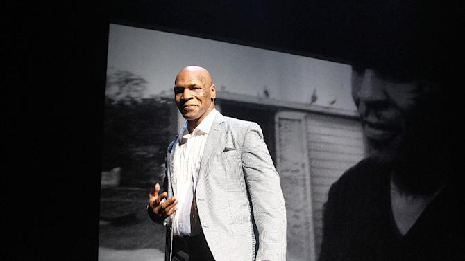 FILE - In this Aug. 2, 2012 file photo, former boxer Mike Tyson takes part in a curtain call following his 'Mike Tyson: Undisputed Truth' performance in New York. Tyson will take his one-man show on a three-month tour to more than a dozen cities, including Chicago, San Francisco, Los Angeles, Detroit and Washington, D.C. The tour starts in Indianapolis in February. (Photo by Donald Traill/Invision/AP, File)