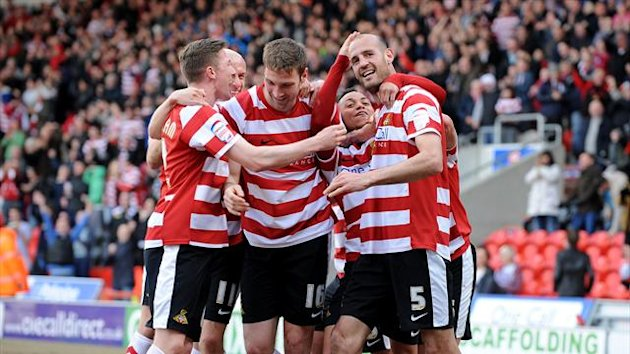 Rob Jones, right, celebrates with his team-mates after scoring Doncaster's winner against Tranmere (PA Photos)