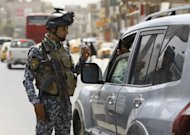 Iraqi police stop vehicles at a checkpoint in central Baghdad. Al-Qaeda's front group in Iraq says a wave of attacks that killed 113 days earlier marked the launch of a new offensive, as officials said five people died in a car bomb north of Baghdad
