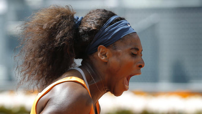 Serena Williams from U.S. reacts during her game against Anabel Medina from Spain during the Madrid Open tennis tournament, in Madrid,  Friday, May 10, 2013. (AP Photo/Daniel Ochoa de Olza)