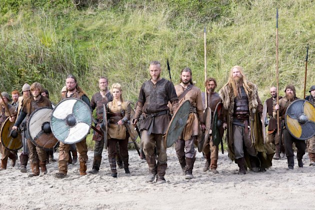 "This image released by History shows Travis Fimmel as Ragnar, center, in a scene from ""Vikings,"" premiering Sunday, March 3 on History. (AP Photo/History, Jonathan Hession)"