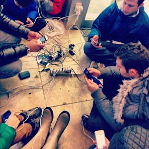 Powerless New Yorkers Find Creative Ways to Charge Gadgets [PICS]