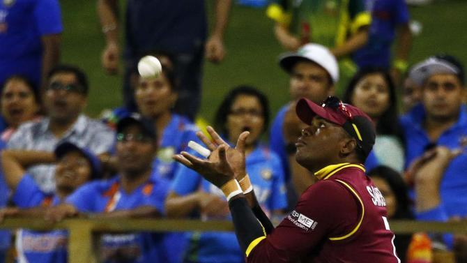 West Indies Marlon Samuels catches out India's batsman Ravindra Jadeja during their Cricket World Cup match in Perth