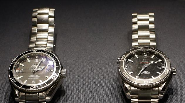 Two Omega watches, left, a Seamaster Planet Ocean model used by Daniel Craig in the James Bond movie 'Quantum of Solace', and a Seamaster Planet Ocean model which is made of Titanium and used by Craig for an action sequence in the upcoming James Bond movie 'Skyfall' is seen during the press preview of the James Bond movie memorabilia charity auction.  The watches are expected to sell for around 6-8,000 British pounds ($ 9,100-12,00 euro 6,800-9,000) each with proceeds going to UNICEF and ORBIS charities.