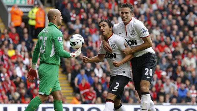 Liverpool v Manchester United - Rafael and Robin van Persie celebrate - September 2012