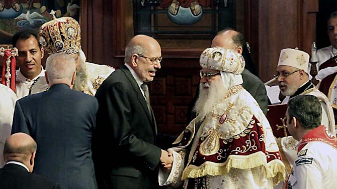 Nobel Peace Prize winner and head of the opposition Egyptian Constitution political party, Mohamed El Baradei, third left, shakes hands with Bishop Bakhomious, the acting head of the Coptic Church, during an elaborate ceremony, in the Coptic Cathedral in Cairo, Egypt, Sunday, Nov. 18, 2012. Tawadros did not address the televised ceremony, but had a brief speech read on his behalf by one of the church's leaders in which he pledged to work for the good of Egypt, with its Muslims and Christians alike. Pope Tawadros II, 60, is seen, second left. (AP Photo/Sami Wahib)