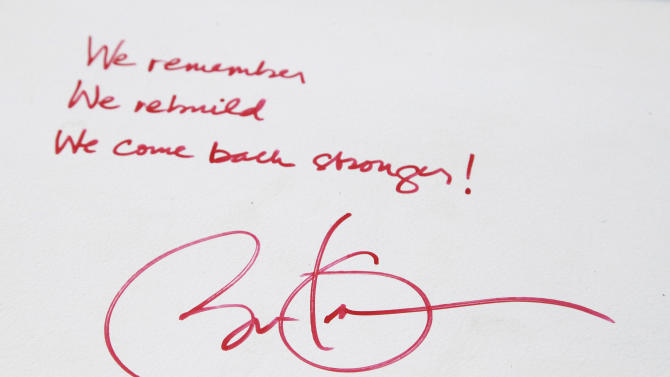 FILE- This Aug. 2, 2012 file photo shows President Barack Obama's message and signature on a steel beam at One World Trade Center in New York. The president's words will join those of numerous construction workers at the site who left personal messages on the beams, when they will be sealed behind the facade of the buildings as they progress toward their 2014 completion date. (AP Photo/Mark Lennihan, File)