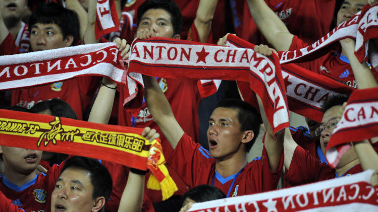 Guangzhou Evergrande fans cheer on their team as they play against Qingdao Junoon, with World Cup-winning Italian coach Marcello Lippi as the head coach, at the Tianhe stadium in Guangzhou, south China's Guangdong province on May 20, 2012.  Guangzhou beat Qingdao 1-0 to remain top of the table in the Chinese football Super League.     CHINA OUT          AFP PHOTOSTR/AFP/GettyImages
