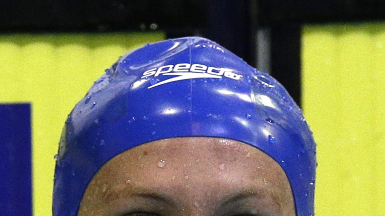 Britain's gold medal winner Jazmin Carlin reacts after the women's 800m freestyle final at the LEN Swimming European Championships in Berlin, Germany, Thursday, Aug. 21, 2014. (AP Photo/Michael Sohn)