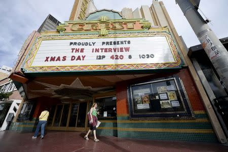 Patriotism mixed with jokes as fans stream 'The Interview'