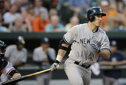 New York Yankees designated hitter Travis Hafner follows through with and RBI single that drove in Vernon Wells during the fourth inning of a baseball game against the Baltimore Orioles, Tuesday, May