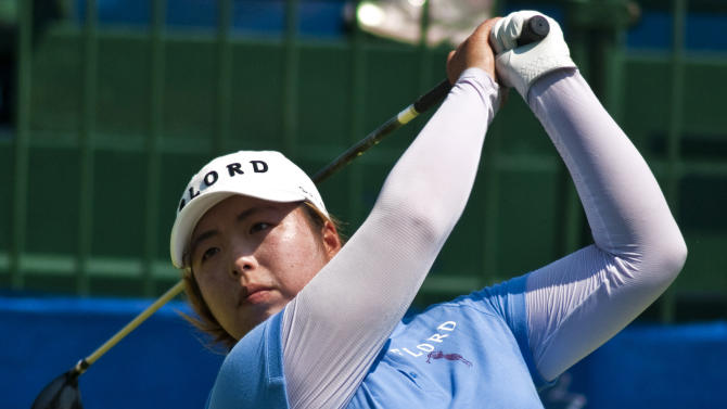 Shanshan Feng of China, follows through on her tee shot on the first hole during the second round of the LPGA NW Arkansas Championship golf tournament in Rogers, Ark., Saturday, June 30, 2012. (AP Photo/April L. Brown)