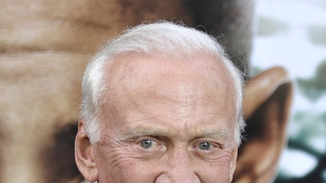 """This May 29, 2013 photo shows former astronaut Buzz Aldrin at the """"After Earth"""" premiere at the Ziegfeld Theatre in New York. (Photo by Evan Agostini/Invision/AP)"""