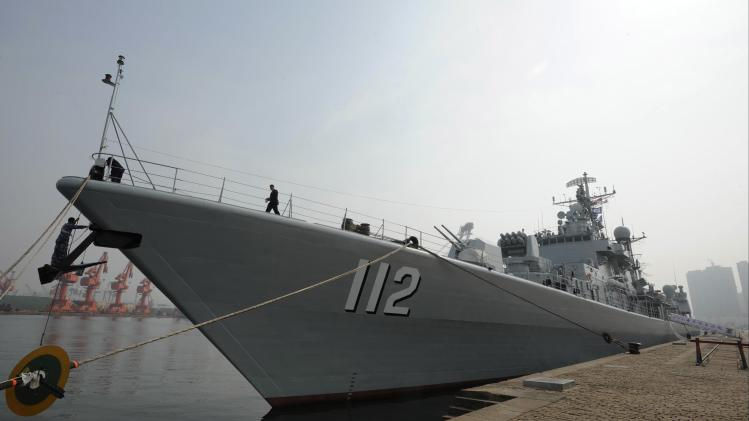 Chinese naval missile destroyer Harbin is seen docked at a military port after its arrival before a maritime drill during the Western Pacific Naval Symposium in Qingdao