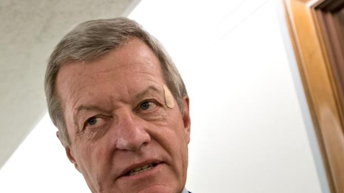 FILE - In this Sept. 19, 2012 file photo, Senate Finance Committee Chairman Max Baucus, D-Mont. speaks reporters on Capitol Hill in Washington. According to Democratic officials: The six-term Democratic Sen. Max Baucus plans to retire.   (AP Photo/J. Scott Applewhite, File)
