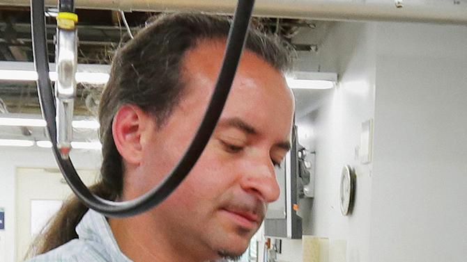 This July 2012 photo shows Andrew Engeldinger working at Accent Signage in Minneapolis. Police say the gunman who killed four people inside a Minneapolis sign company had been fired hours before the attack. Minneapolis Police Chief Tim Dolan told a Friday, Sept. 28, 2012, news conference that the gunman in Thursday's attack was 36-year-old Engeldinger of Minneapolis. (AP Photo/Finance and Commerce, Bill Klotz) MANDATORY CREDIT
