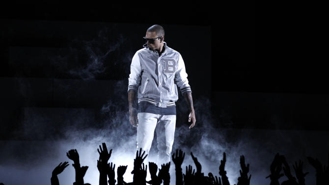 FILE - In this Feb. 12, 2012 file photo, Chris Brown performs during the 54th annual Grammy Awards in Los Angeles. Brown's community service records have come under the scrutiny by a prosecutor and a judge, who are trying to ascertain their accuracy.  He was required to perform community service after the 2009 beating of former girlfriend, Rihanna. (AP Photo/Matt Sayles, File)