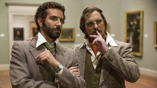 "This film image released by Sony Pictures shows Bradley Cooper, left, and Christian Bale in a scene from ""American Hustle."" The New York Film Critics Circle named ""American Hustle"" the best film of 2013, giving David O. Russell's fictionalized Abscam tale an early jolt in Hollywood's awards season. (AP Photo/Sony - Columbia Pictures, Francois Duhamel)"
