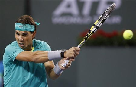 Rafael Nadal of Spain hits a return against Ryan Harrison of the U.S. during their match at the BNP Paribas Open ATP tennis tournament in Indian Wells