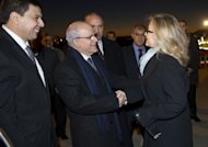 Algerian Foreign Minister Mourad Medelci (C) greets US Secretary of State Hillary Clinton upon arrival at Houari Boumediene Airport in Algiers. Clinton Monday pressed Algerian President Abdelaziz Bouteflika to support possible military action in neighbouring Mali, where Islamists control large areas of the north