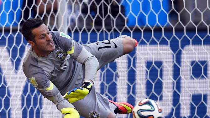 Brazil's goalkeeper Julio Cesar makes a save during the penalty shootout with Chile at The Mineirao Stadium in Belo Horizonte during the 2014 FIFA World Cup on June 28, 2014