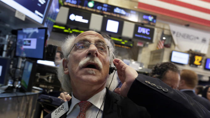 FILE - In this Friday, Jan. 17, 204, file photo, Trader Peter Tuchman works on the floor of the New York Stock Exchange. (AP Photo/Richard Drew)