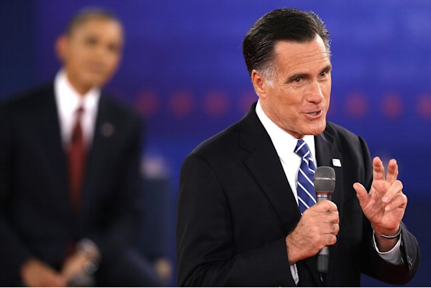 Republican presidential nominee Mitt Romney speaks while President Barack Obama listens during the second presidential debate at Hofstra University, Tuesday, Oct. 16, 2012, in Hempstead, N.Y. (AP Phot