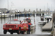 As Hurricane Sandy moves up the East Coast, members of the Highlands Fire Department remove the rescue boat from the Atlantic Highlands Marina, Friday Oct. 26, 2012 in Atlantic Highlands, N.J. (AP Photo/Joe Epstein)