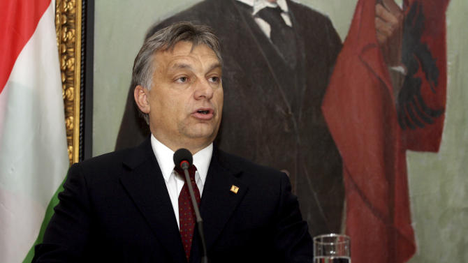 "FILE - This is a Wednesday, Nov. 28, 2012 file photo of Hungarian Prime Minister Victor Orban as he speaks at a news conference in Tirana where he went to celebrate Albania's 100th anniversary of independence. A Hungarian opposition group said Tuesday July 29, 2014 it would ask the European Union to step up its oversight of democracy in Hungary after the Prime Minster Vicktor Orban said he wants to transform the country from a liberal democracy into an ""illiberal state.""(AP Photo/Hektor Pustina, File)"