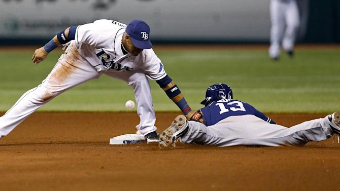 San Diego Padres' Chris Denorfia, right, slides in safely with a steal of second base as Tampa Bay Rays shortstop Yunel Escobar cannot hold on to the throw during the fourth inning of an interleague baseball game, Friday, May 10, 2013, in St. Petersburg, Fla. (AP Photo/Mike Carlson)