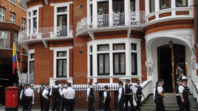 British police officers stand guard outside the Ecuadorian Embassy in central London, Thursday, Aug. 16, 2012 after Ecuadorean Foreign Minister Ricardo Patino announced that he had granted political asylum to WikiLeaks founder Julian Assange.  He's won asylum in Ecuador, but Julian Assange is no closer to getting there. The dramatic decision by the Latin American nation to identify the WikiLeaks founder as a political refugee is a symbolic boost for the embattled ex-hacker, but legal experts say that does little to help him avoid extradition to Sweden — and does much to drag Britain and Ecuador into a contentious international faceoff. (AP Photo/Sang Tan)