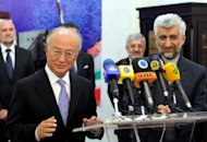International Atomic Energy Agency (IAEA) chief Yukiya Amano (left) speaks during a press conference as Iran&#39;s chief nuclear negotiator Said Jalili (R) looks on in Tehran on Monday. Amano and Jalili hailed &quot;intensive&quot; and &quot;very good&quot; talks on Iran&#39;s nuclear programme, state television says