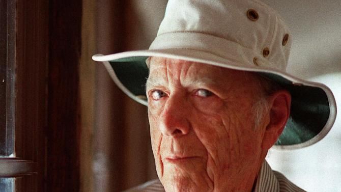 "FILE - This May 15, 2000, file photo, shows author Herman Wouk in Palm Springs, Calif. In the fall of 2012, new works came out from 97-year-old novelist Wouk, 93-year-old poet Lawrence Ferlinghetti and 90-year-old historian Bernard Bailyn. Wouk's editor, Jonathan Karp, says that Wouk has always taken good care of himself. The author's first book came out more than 60 years ago, but his lifestyle has remained steady _ work, family and religious faith, studying the Torah daily. The author of such favorites as ""The Caine Munity"" and ""The Winds of War"" keeps up with modern trends, working in Skype and text messages for his latest, ""The Lawgiver."" (AP Photo/Douglas L. Benc Jr., File)"