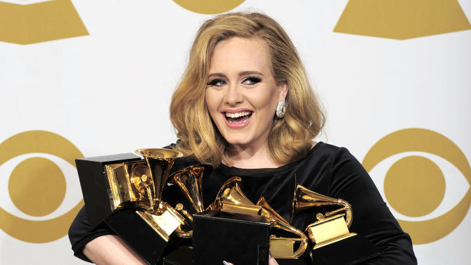 "FILE - This is a Sunday, Feb. 12, 2012 file photo of Adele as she poses backstage with her six awards at the 54th annual Grammy Awards on Sunday, Feb. 12, 2012 in Los Angeles. Adele won awards for best pop solo performance for ""Someone Like You,"" song of the year, record of the year, and best short form music video for ""Rolling in the Deep,"" and album of the year and best pop vocal album for ""21."" Adele is getting a new medal to go alongside her Grammys and Academy Award _ an honor from Queen Elizabeth II. The ""Rumor Has It"" and ""Skyfall"" singer was named a Member of the Order of the British Empire, or MBE on Friday June 14, 2013 in the queen's annual Birthday Honors list. (AP Photo/Mark J. Terrill, File)"