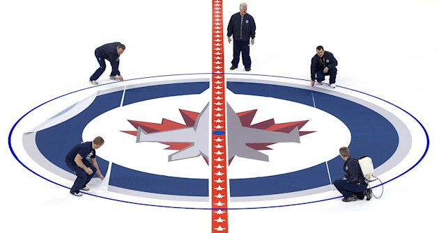 Winnipeg Jets Install Logo And Lines In MTS Centre Ice