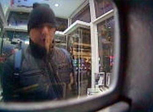 """This Feb. 19, 2013 surveillance image released by the U.S. Attorney's Office in New York City shows a man referred to as """"defendant Reyes"""" allegedly using  fraudulent magnetic cards to steal money from one of several cash machines in Manhattan. Federal prosecutors on Thursday, May 9, 2013, said that a gang of cyber-criminals stole $45 million in a matter of hours by hacking their way into a database of prepaid debit cards and then draining cash machines around the globe. (AP Photo/U.S. Attorney's Office)"""