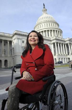 "FILE - In this Jan. 3, 2013 file photo, then-Rep.-elect Tammy Duckworth, D-Ill. is seen on Capitol Hill in Washington. The House overwhelmingly passed a sweeping, $638 billion defense bill on Friday that imposes new punishments on members of the armed services found guilty of rape or sexual assault as outrage over the crisis in the military has galvanized Congress. Duckworth, who lost both legs and partial use of an arm in a rocket-propelled grenade attack in Iraq, told her colleagues in the final moments of debate on Friday, ""This is a self-inflicted wound that has no place in the military"". (AP Photo/Cliff Owen, File)"