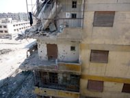 <p>A photo released by the Syrian opposition's Shaam News Network on Monday shows the destruction of a residential building in the restive Syrian city of Homs on June 20. NATO members were holding emergency talks on Syria's downing of a Turkish warplane, as a monitoring group reported fierce clashes on Tuesday around elite Republican Guard posts in suburbs of Damascus.</p>