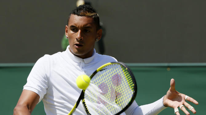 Nick Kyrgios of Australia hits a shot during his match against Milos Raonic of Canada at the Wimbledon Tennis Championships in London