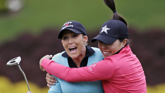 Cristie Kerr is hugged by Irene Cho, right, as Kerr celebrates winning the Kingsmill Championship LPGA golf tournament in Williamsburg, Va., Sunday, May 5, 2013. Kerr made a short par putt on the second hole of a sudden-death playoff with Suzann Pettersen for the victory. (AP Photo/Steve Helber)