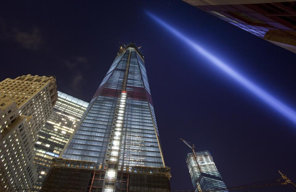 A test of the Tribute in Light shines skyward over One World Trade Center, center, and lower Manhattan, Friday, Sept. 7, 2012 in New York. The tribute will shine the night of Tuesday, Sept. 11 over New York, eleven years after the terrorist attacks. (AP Photo/Mark Lennihan)