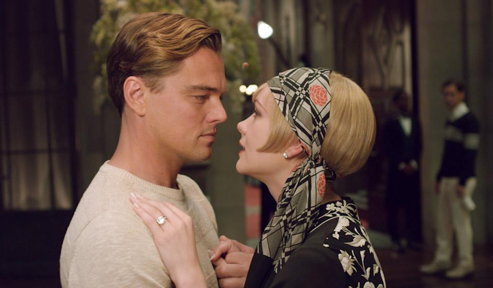 "This film publicity image released by Warner Bros. Pictures shows Carey Mulligan as Daisy Buchanan, right, and Leonardo DiCaprio as Jay Gatsby in a scene from ""The Great Gatsby."" (AP Photo/Warner Bros. Pictures)"
