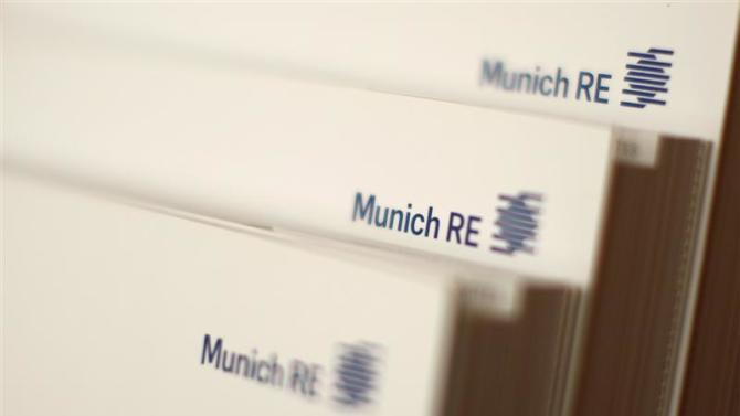 Books by world's biggest reinsurer Munich Re are pictured in office building in Munich