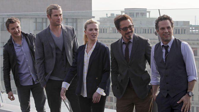 """FILE - In this Tuesday, April 17, 2012 file photo, from left, actors Jeremy Renner, Chris Hemsworth, Scarlett Johansson, Robert Downey Jr., and Mark Ruffalo, pose for photographers at a hotel during a photocall for the film """"The Avengers"""" in Moscow, Russia. Billionaire genius Tony Stark had to learn to play well with others in """"The Avengers"""" after two """"Iron Man"""" films where he was the main attraction. So did Downey, though his path to superhero team player came without the fisticuffs and rivalries that Stark stumbles into with his fellow Avengers, who beat up on one another a bit before they figure out how to work as a group. (AP Photo/Misha Japaridze)"""