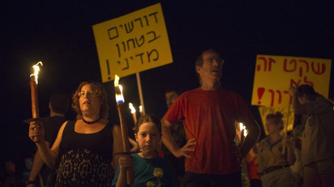Residents of Israel's southern communities take part in a protest near the town of Sderot calling for a long term solution to the tunnel and rocket threat from Gaza
