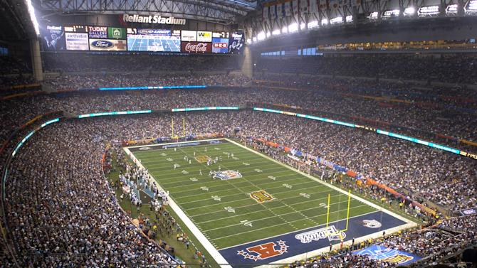 FILE - In this Feb. 1, 2004 file photo,Houston's Reliant Stadium hosts a sellout crowd at Super Bowl XXXVIII between the Carolina Panthers and the New England Patriots in Houston. NFL owners will vote on the sites of the 50th and 51st Super Bowls on Tuesday, May 21, 2013 at their spring meetings. The San Francisco area, where a new stadium is being built in Santa Clara, and South Florida are competing for the the 50th edition, to be held in February 2016. The loser in that bidding will go against Houston to host the 51st game the following year. (AP Photo/Brett Coomer, File)