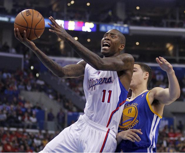 Los Angeles Clippers guard Jamal Crawford, left, drives to the basket with Golden State Warriors guard Klay Thompson, right, defending in the second quarter during an NBA basketball game on Thursday,