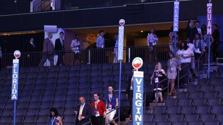 Visitors walk past delegate seats during the public unveiling of Democratic National Convention's facilities Time Warner Arena in Charlotte, N.C., Friday, Aug. 31, 2012. (AP Photo/Chuck Burton)